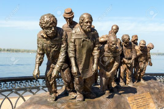 "SAMARA, RUSSIA - SEPTEMBER 12, 2014: Bronze monument of a painting of Ilya Repin's ""Barge Haulers on the Volga"". Fragment. Monument was unveiled on September 11, 2014"